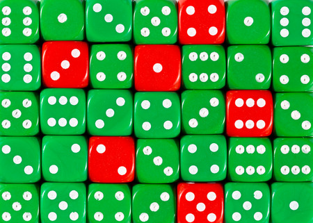 Pattern background of random ordered green dices with six red cubes