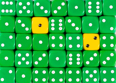 Pattern background of random ordered green dices with two yellow cubes