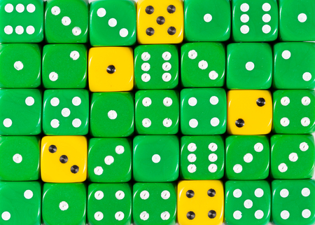 Pattern background of random ordered green dices with five yellow cubes Foto de archivo