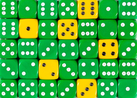 Pattern background of random ordered green dices with six yellow cubes