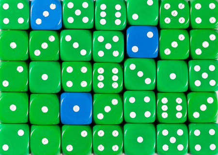 Pattern background of random ordered green dices with three blue cubes