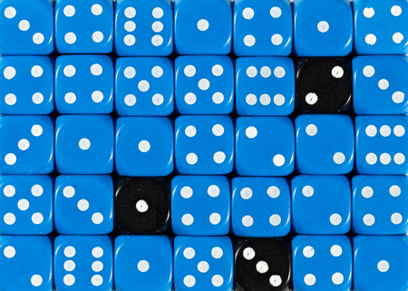 Pattern background of random ordered blue dices with three black cubes Foto de archivo