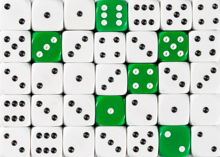 Pattern background of random ordered white dices with six green cubes Foto de archivo
