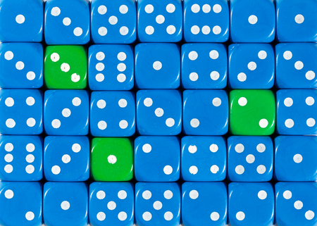 Pattern background of random ordered blue dices with three green cubes