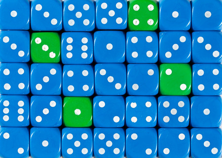 Pattern background of random ordered blue dices with four green cubes Imagens