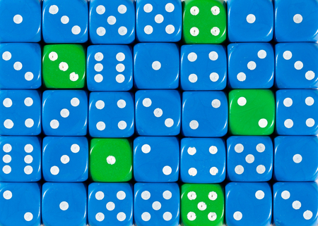 Pattern background of random ordered blue dices with five green cubes Stok Fotoğraf - 121666606