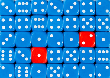 Pattern background of random ordered blue dices with two red cubes