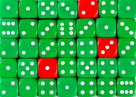 Pattern background of random ordered green dices with three red cubes