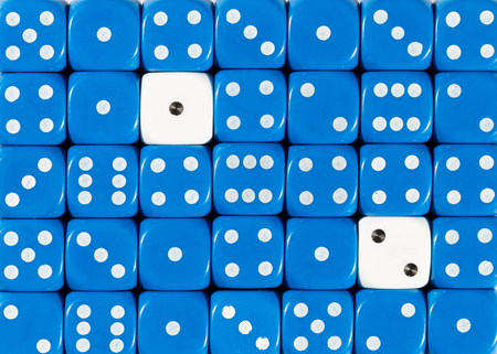 Pattern background of random ordered blue dices with two white cubes Stok Fotoğraf