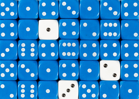 Pattern background of random ordered blue dices with three white cubes