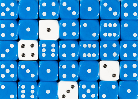 Pattern background of random ordered blue dices with four white cubes