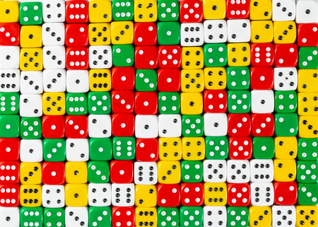 Pattern background of random ordered red, white, yellow and green dices
