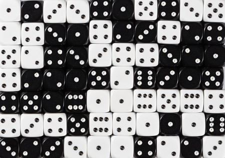Pattern background of 70 random ordered black and white dices Stok Fotoğraf