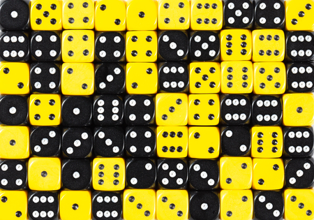 yellowPattern background of 70 random ordered black and yellow dices Foto de archivo