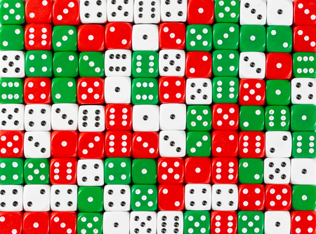 Pattern background of random ordered white, red and green dices