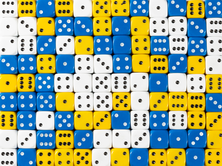 Pattern background of random ordered white, blue and yellow dices Stok Fotoğraf