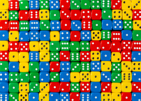 Pattern background of random ordered red, yellow, green and blue dices