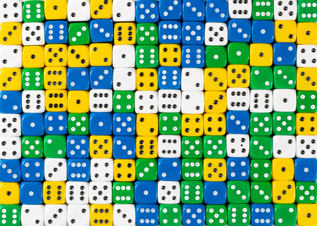 Pattern background of random ordered white, yellow, green and blue dices Stok Fotoğraf