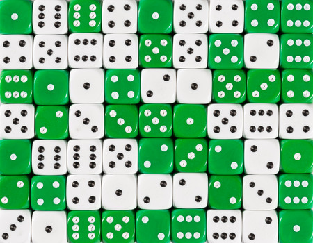 Pattern background of 70 random ordered white and green dices Foto de archivo