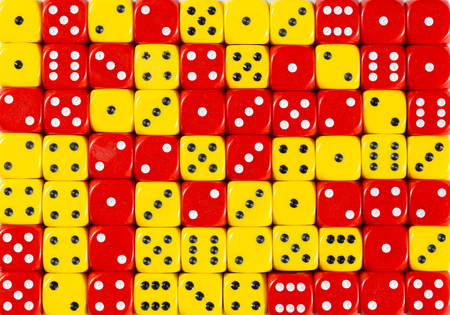 Pattern background of 70 random ordered red and yellow dices Stok Fotoğraf