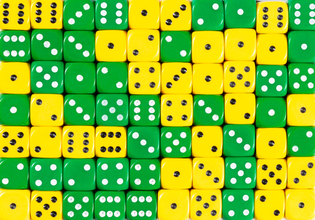 yellowPattern background of 70 random ordered yellow and green dices Foto de archivo