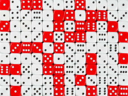 Pattern background with two-third random ordered white dices and one-third red dices