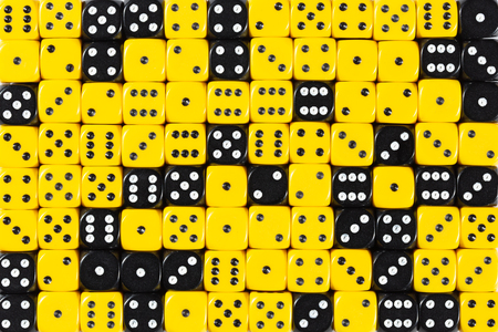 Pattern background with two-third random ordered yellow dices and one-third black dices