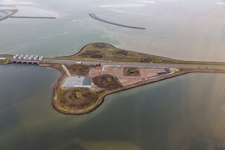 Aerial view industrial storage area near Den Oever at Dutch dike Afsluitdijk, separation between the fresh water lake IJsselmeer and the salt Wadden Sea Reklamní fotografie