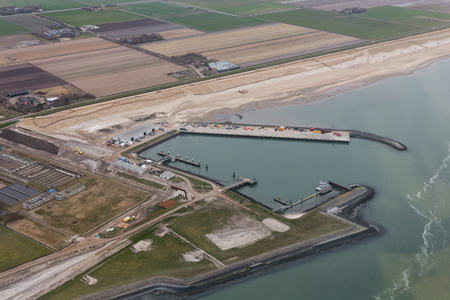 Aerial view service harbor at Dutch island Texel in Wadden sea