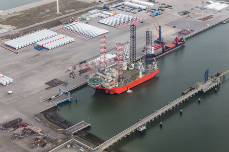 Dutch harbor Eemshaven with crane platform for installing offshore wind turbines at sea