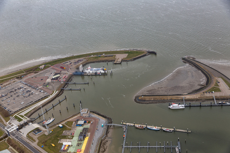 Aerial view harbor and industrial park Lauwersoog at Dutch coast of Wadden Sea Stock Photo