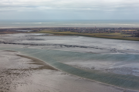 Aerial view Dutch island Schiermonnikoog with lighthouse sand low tide at waddensea Stock Photo