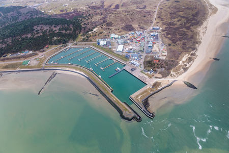 Aerial view Marina with storage area at Dutch island Vlieland in Wadden sea