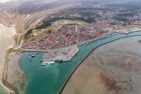 Aerial view harbor and Village Terschelling, Dutch island in Wadden sea