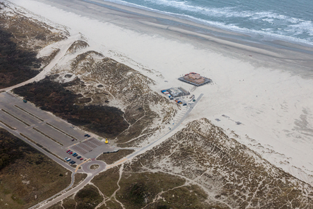 Aerial view construction new beach pavilion at Dutch island Terschelling with large car park Stock Photo