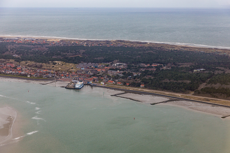 Aerial view Dutch island Vlieland with village and pier ferry terminal Stock Photo