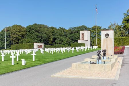 Hamm near Luxembourg city, Luxembourg - August 22, 2018: American WW2 Cemetery with memorial monument, fountain and headstones of 5073 buried soldiers