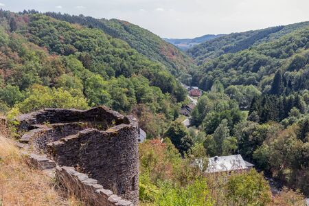 Medieval ruin of Brandenbourg castle at hill in Luxembourg Ardennes 70 meter above village of Brandenbourg