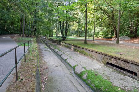 Park downtown Luxembourg city with footpath along Petrusse creek, affluent of Alzette river Imagens