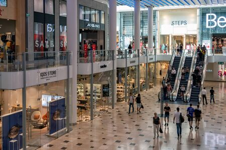 Utrecht, The Netherlands - July 05, 2018: Interior modern new shopping centre Hoog Catharijne with escalator and shopping people Editorial