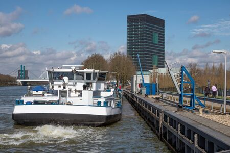 Dutch Amsterdam-Rijn canal with ship mooring at oil transit point near Utrecht