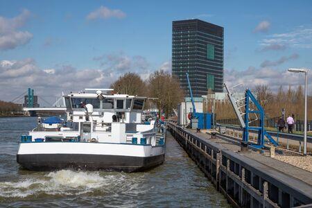 Dutch Amsterdam-Rijn canal with ship mooring at oil transit point near Utrecht Stock fotó