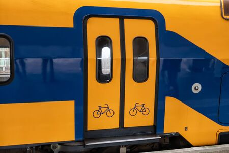 Train at Dutch railway platform with closed doors Фото со стока