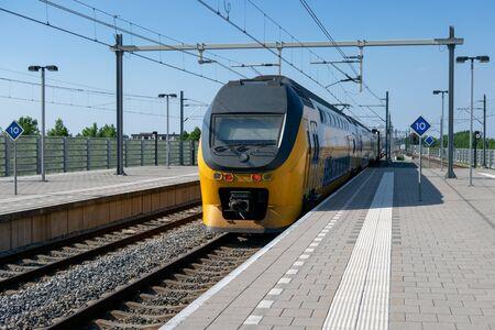 Express train arriving at central station Lelystad, the Netherlands Imagens