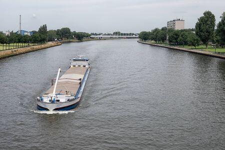 Large inland ship at Dutch Amsterdam Rijn canal sailing near city Utrecht Stock fotó