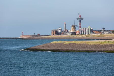 Seascape harbor Dutch city Vlissingen at Westerschelde with lighthouse and houses