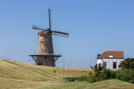 Traditional windmill at dike near Vlissingen, The Netherlands