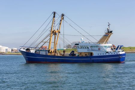 Dutch fishing cutter sailing into harbor Vlissingen, The Netherlands