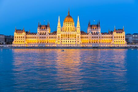 Hungarian Parliament Building along river Danube at night, seat of National Assembly of Hungary