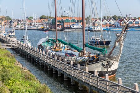 Historic sailing ship moored at pier of Dutch fishing village Urk Banco de Imagens